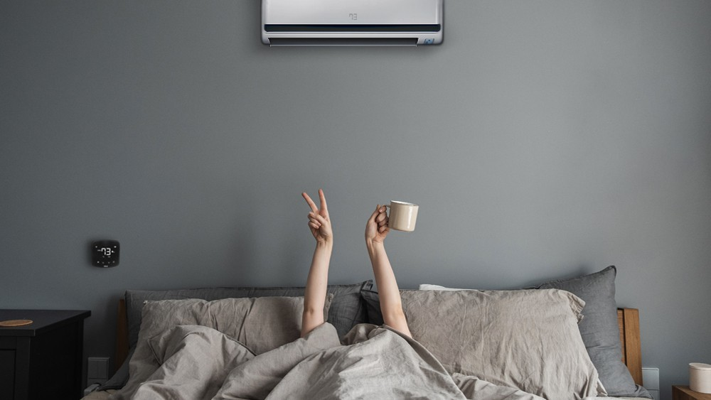 Woman enjoying morning coffee courtesy of ideal daytime temperature by Cielo Breez