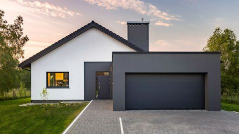 Modern house with a gray themed garage attached to the front