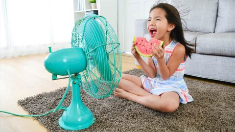 A girls eating watermelon and enjoying summer season